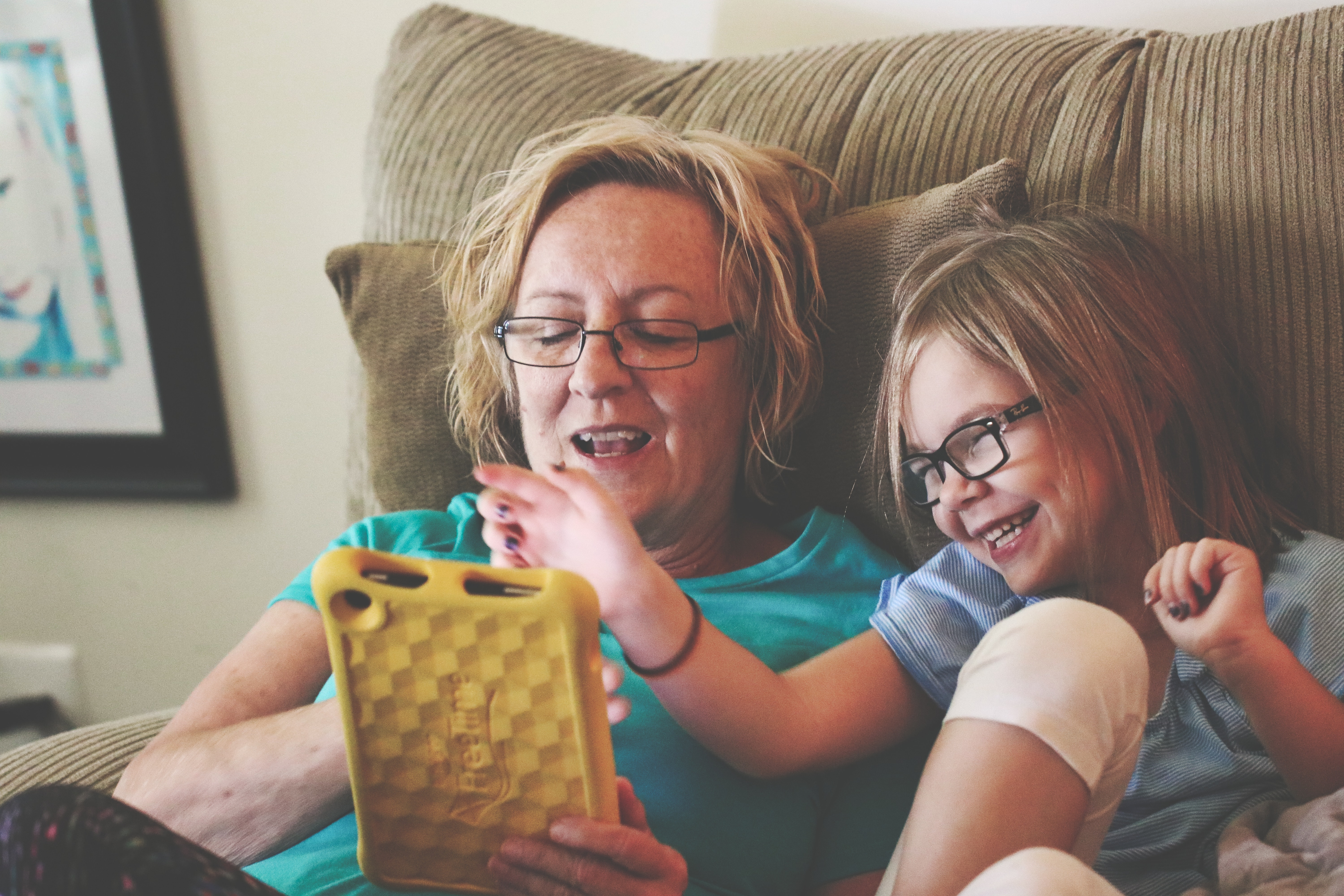 Image of a woman with a child using a tablet - using demographics rather than life stage in our customer persona may stereotype the woman