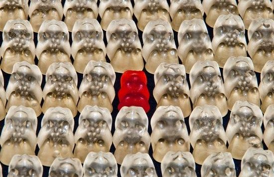 Image shows clear jelly sweets laid out in rows, with 1 red sweet in the middle - targeting your customer with customer personas or avatars
