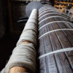 Rovings (long strips of wool ready for spinning) on a roller