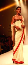 a-model-walks-the-ramp-displaying-an-outfit-by-397716
