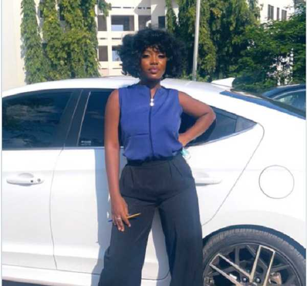 Singer Gyakie posed for the camera after her last paper at KNUST