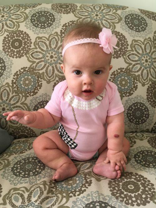 baby with pink headband