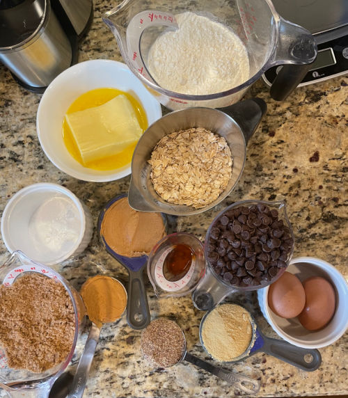 Ingredients in Peanut Butter Chocolate Chip Lactation Bars - flour, butter, oats, chocolate chips, 2 eggs, vanilla, brewer's yeast, flaxseed, peanut butter, brown sugar, baking powder, baking soda, salt