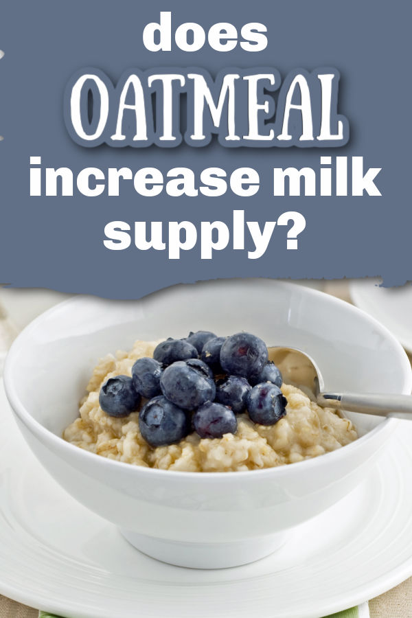 blueberries on top of oatmeal in a white bowl with a spoon with text overlay Does Oatmeal increase milk supply?