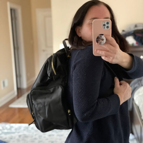 Idaho Jones breast pump backpack on a woman wearing a navy sweater