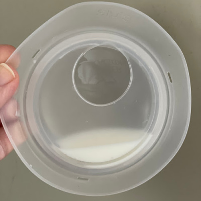 Elvie Catch with a small amount of breastmilk in it