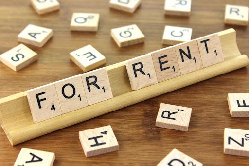 'For rent' is spelt using scrabble tiles