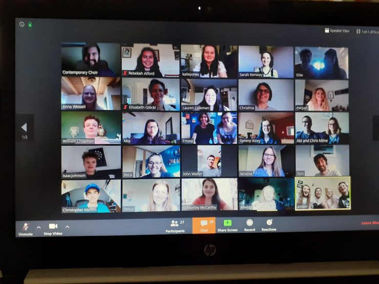 A photo of a Zoom video call with 25 people on a laptop