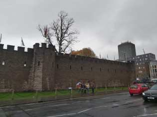 The wall of a castle on a cloudy day