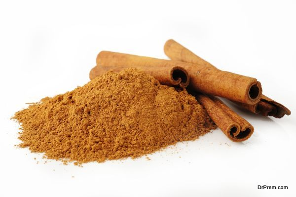 cinnamon powder on white background