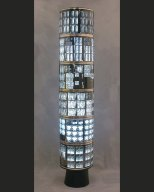 Installation tall sculpture, numerous x-rays around a light box