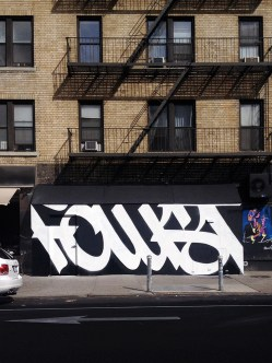 FAUST spray painted on a building
