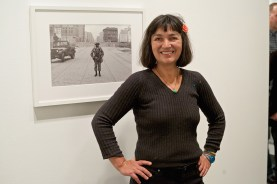 Elke Susannah Freed, daughter of photographer Leonard Freed, stands by one of her father's photographs exhibited in The Wall in Our Heads.