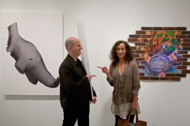 (L-R) Artists James Huckenpahler and Nilay Lawson stand by their respective works in The Wall in Our Heads.