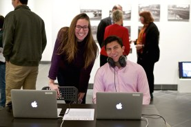 (L-R) Rachel Davies '16 and Jason Bravo '19 interacting with a class project Bravo worked on at the Transdivisional Student Exhibition.