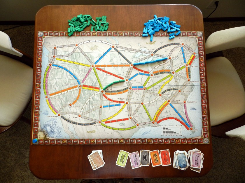 Staged photo to show that Ticket to Ride fits on the Meco Folding Card Table.
