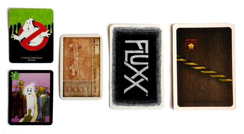 Cards from Protect the Barrier compared to cards from Ticket to Ride, Fluxx, and The Resistance.