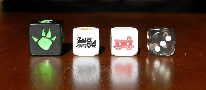 Dice comparison: King of Tokyo (left), Trainmaker (center), Chessex 16mm (right).