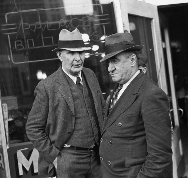 Men in front of pool hall, Omaha, Nebraska; photographed by John Vachon