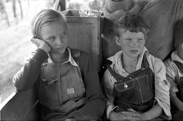 Migrant children sitting in back seat of family car east of Fort Gibson, Muskogee County, Ok
