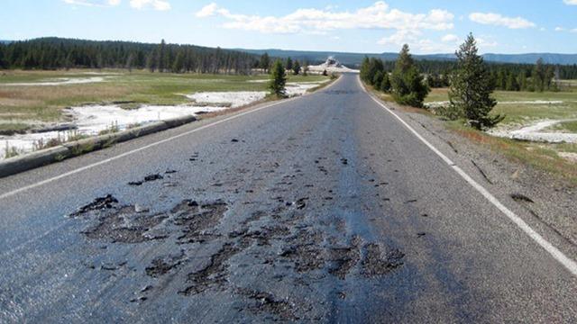 Firehole Lake Road melting, Yellowstone National Park, Wyoming, August 19, 2014