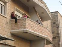 07. sitting on the balcony