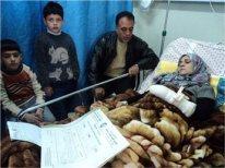 Suad Jaara was shot in the hand by an Israeli soldier who killed her friend Lubna al-Hanash near Hebron on Jan. 23. (MaanImages)