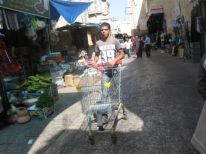 12. a young man in the shopping street