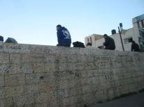 08. sitting on a wall in Ramallah
