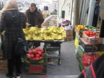 03. selling fruits near parking place for taxis in Bethlehem