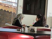 18. two women in a restaurant