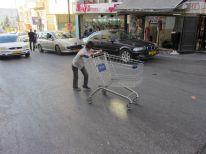 24. a boy with a shopping basket