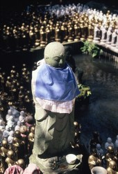 Jizo statues. The Japanese divinity Jizo is revered as the protector of children, mothers, and travelers.