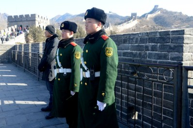 Guards standing at the Great Wall. Photo by Alice Bacani