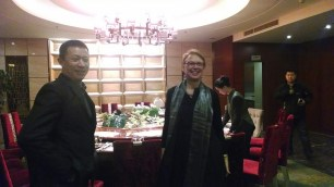 Susan Petry and the Dean of Changchun University. Photo by Leisa DeCarlo.