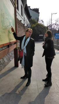 Susan Petry and Kelly Hurlburt looking at a Chinese map. Photo by Leisa DeCarlo.
