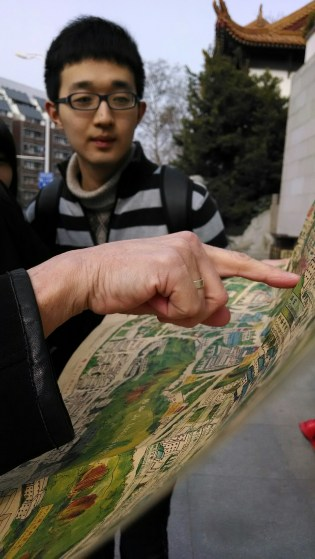 Susan Petry shows Ernest a map of Yellow Crane Tower. Photo by Leisa DeCarlo.