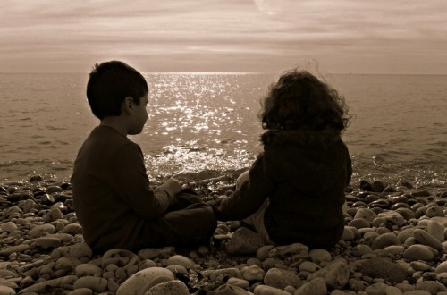 Children sitting on the lakeshore, Lake Ontario