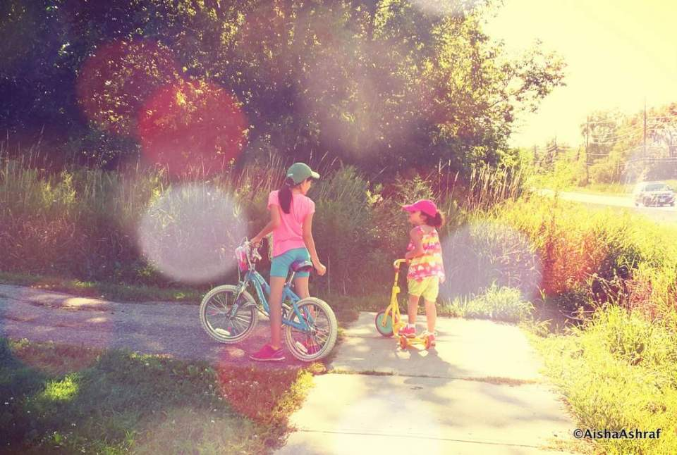 two children on bikes who've stopped to talk