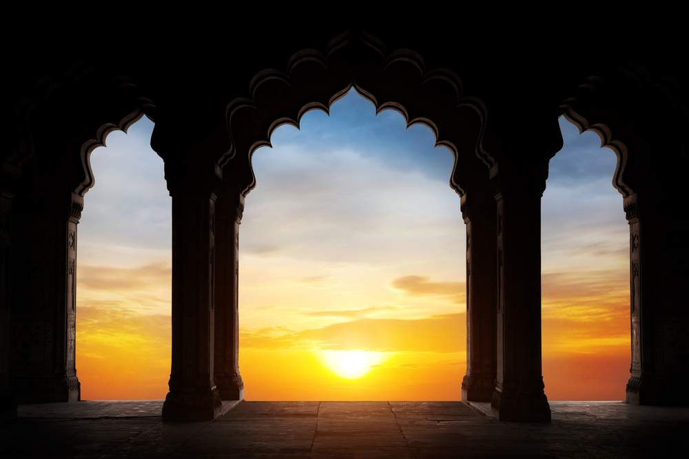 Sunset through a scalloped archway