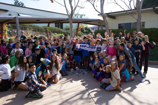 2015-02-04_usa-santa-barbara_hope-school-students-showing-clean-up-results-with-flag.jpg