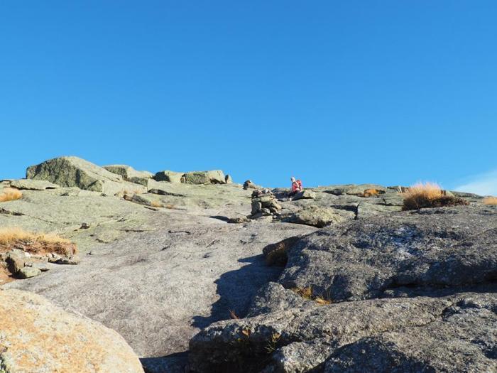 girl climbing up the rocks