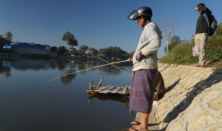 Locals fishing with bamboo rods in Loikaw