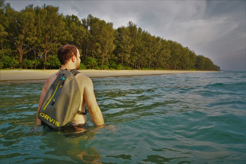 The Orvis Waterproof Slingpack kept the towel dry while swimming in the sea