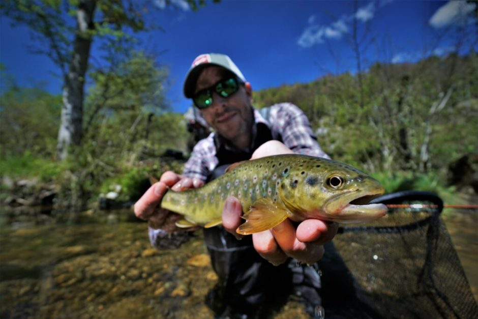André with a lovely brown trout caught on a dry with the Sage TXL-F #4.