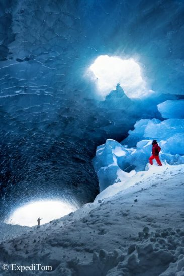 The crack in the roof of the ice cave, which allowed a sunbeam to enter.