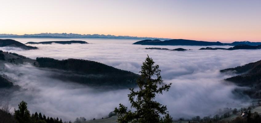 Swiss Alps Panorama beyond the fog
