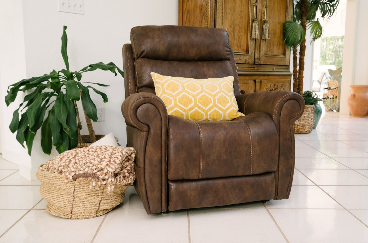 Brown Power Lift Recliner VivaLift in a room next to a standing plant