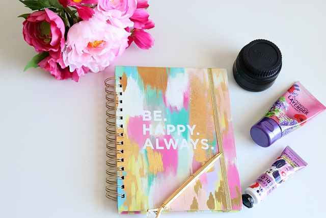 """Notebook with insp[irational quote """"Be Happy Always"""" Self Care Scene"""