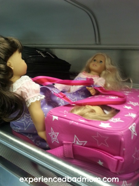 American Girl dolls on the train